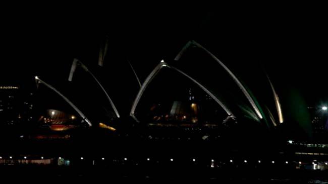 la opera de sydney apagada la iluminacion